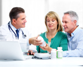 senior couple visiting a pharmacist